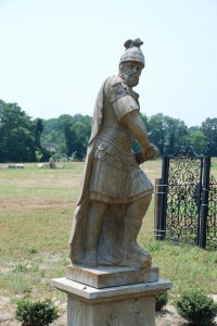 hand carved stone roman soldier statue on pedestal at charlies antiques in williamsburg va