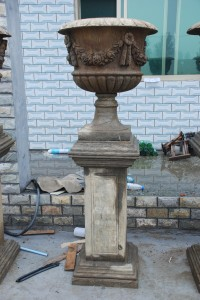 Handcarved stone urns and pedestals at charlies antiques store in williamsburg va