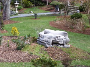 stone boulder in garden at charlies antiques in williamsburg va