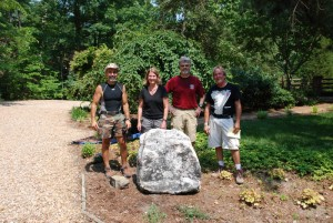 boulder in landscaped yard at charlies antiques in williamsburg va