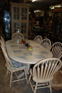pickled oak dining table with inlaid tiles and 8 chairs