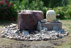 boulder water feature in landscaped garden at charlies antiques in williamsburg va