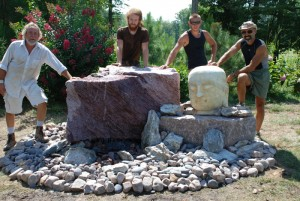 canadian pink boulder water feature with stone head statue from charlies antiques in williamsburg va
