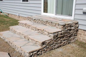landscaped stone steps with fieldstone and pink and tan flagstone at charlies antiques at williamsburg