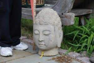 stone buddha head for garden decor at charlies antiques in williamsburg va