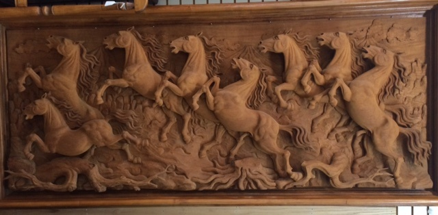 teak horse picture, carved herd of horses teak log ,art wooden horses at charlies antiques in williamsburg va