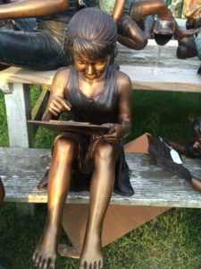 bronze girl reading book, bronze statue, garden statue